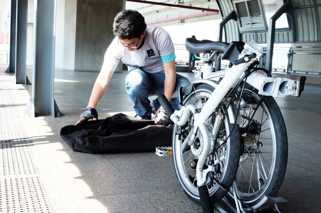 Putting your folding bike into your bike bag.